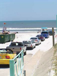 Cars drive onto beach at Daytona Beach, Florida